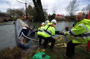 Rescued canal boat to be taken away by crane